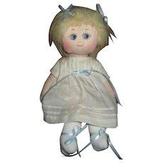 Sweet artist doll with big blue eyes