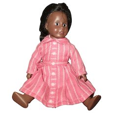 Adorable small vintage black doll