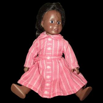 Adorable small vintage black doll