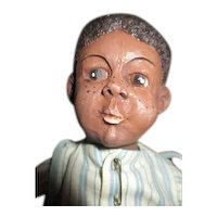 Adorable black boy doll
