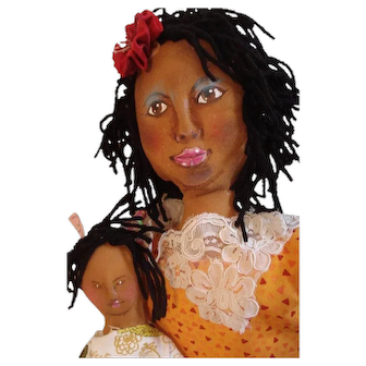 Black doll with a wonderful painted face OOAK