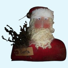 Primitive artist Santa doll head for display