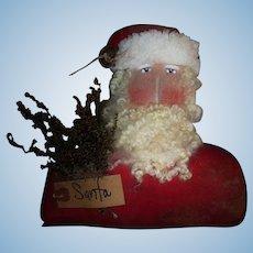 Primitive artist Santa doll head for display