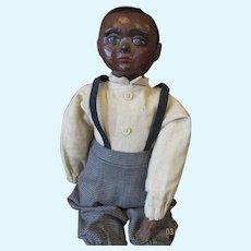 Adorable black boy doll by Sue Johnson