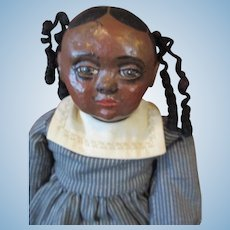 Adorable black doll by  artist Sue Johnson