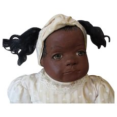 Adorable black original doll by artist  Carolyn Carpin