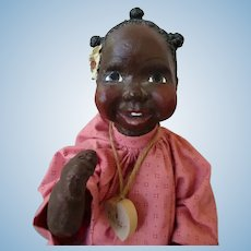 Darling black doll  with a heartwarming smile