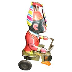 Adorable wind up tin Monkey toy works