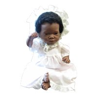 Adorable black baby doll with  earrings