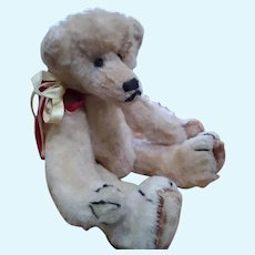 Doll size humpbacked Teddy bear