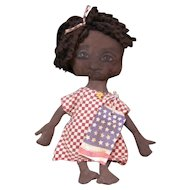 Primitive Black folk art doll with a sweet handpainted face