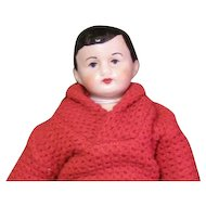 Cute bisque boy doll in a Mattel's Ken sweater