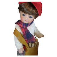 Bisque doll newspaper boy