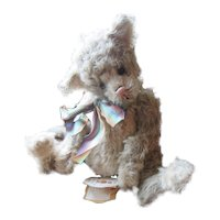 Adorable distressed  simulated mohair Cat