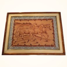 Tanned Leather pyrography of three wild Arabians in the desert