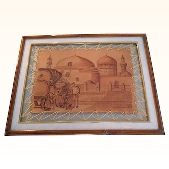 Tanned Leather pyrography of a horse drawn carriage to a local town/village