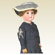 Gans & Seyfarth bisque head doll in sailor dress