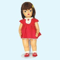 Vintage 1950's Terri Lee Hard Plastic Doll In Tagged Dress.