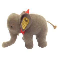 STEIFF next to Smallest Elephant, 10CM with Button and Flag