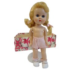 1955-1956 Vogue Ginny doll, straight leg walker in box