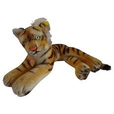 STEIFF 28 CM Lying tiger cub, all IDS