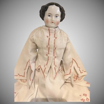 Sweet German porcelain lady doll with sculpted curly hair and vintage costume