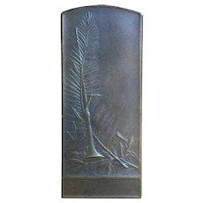 Bronze plaquette by L. Cariat.