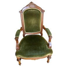 Victorian green upholstered arm chair.