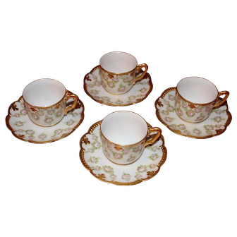 Set of Four Handpainted Limoges Demitasse Cups and Saucers