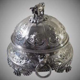 An Ornate Antique Silver Butter Dish With Mounted Cow Lion Mask, Handles & Milk Glass Liner: c1880