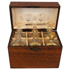 French or English Oak Traveling Liquor Set with Six Gilt Enhanced Bottles, 18th c.