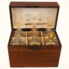 French or English Oak Traveling Liquor Set with Six Gilt Enhanced Bottles, 18th c.