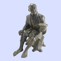 "Japanese bronze okimono of a seated man-Meiji period, 4.75""x3"""