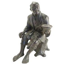 """Japanese bronze okimono of a seated man-Meiji period, 4.75""""x3"""""""
