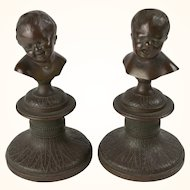 Pair of French bronze busts of crying boy & laughing girl, after Houdon