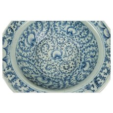 A Late Qing Chinese Export Blue and White Deep Bowl With Abstract Fruits And Florals