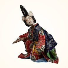 Japanese Kutani Kneeling Figure of a Man-19th c.