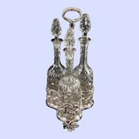 Three Victorian Decanters in Silverplated Caddy
