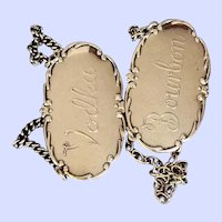 Pair of English sterling bottle tickets