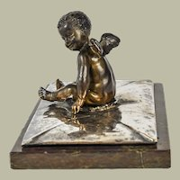 Naked Putto Atop a Silvered Bronze Envelope on Marble Base