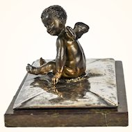 Naked Putti Atop a Silvered Bronze Envelope on Marble Base