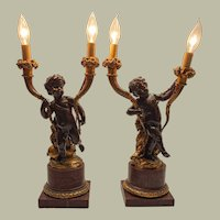 19th c. French patinated bronze and gilt putti candelabras
