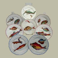 "Eight Limoges fish and sea creature plates c. 1900, 9 1/2"" diameter"
