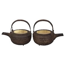 "Matched Pair of Japanese early 19th c. iron tetsubin (teapots), 7""x6""x5"""