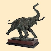 "Impressionistic bronze figure of a rampant elephant on stand, 14"" x 16"""