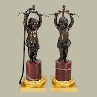 Pair French Belle Epoque bronze female cupids on marble plinths