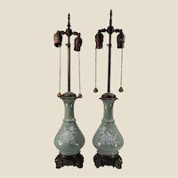 Pair French Sevres celadon pâte sur pâte vases mounted as lamps