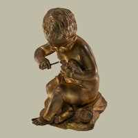 Gilt Bronze Figure of Baby with a Bird