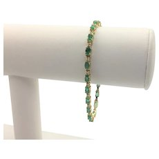 14k Yellow Gold 4ct Emerald and Diamond Tennis Bracelet 7 Inches