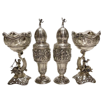 Four Piece Figural .800 Silver Salt and Peppers